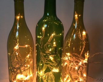 Three green wine bottles w/ lights, set of three light & dark green bottle lights, electric, twinkle, night light, decorative accent lights