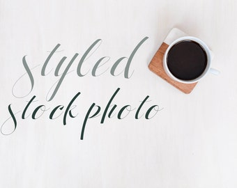 Styled Stock Layflat Photo White with Coffee and Wooden Coaster