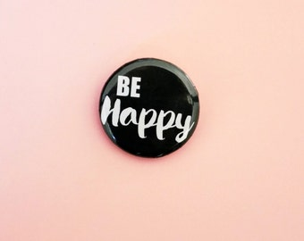 """Round badge """"Be Happy"""", illustrated by pretty Mess. Long of mode & Co"""