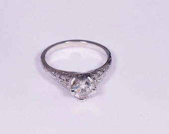 Platinum Diamond Engagement Ring with .66 ct. Center Stone, size 5.5