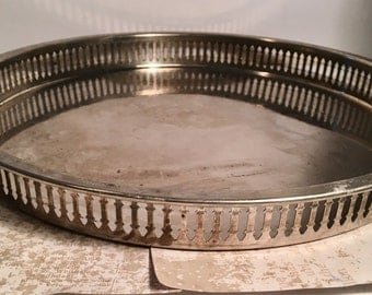 12 inch round Vintage Silverplated on Iron  with raised edge Platter
