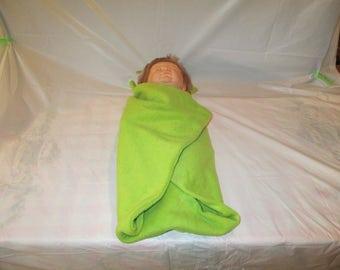 A green frog blanket buddy