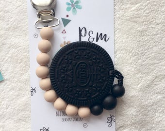 Duo attached pacifier and oreo chocolate style modern, just perfect.