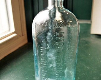 Lydia E Pinkham's 14 1/2 ozs Medicine bottle -clear/light blue -VINTAGE