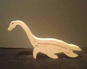 This is a scroll sawn plesiosaur puzzle