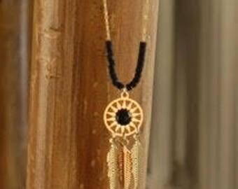 Native American style brass pendant