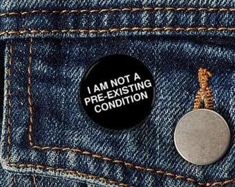"I Am Not A Pre-Existing Condition Plain 1"" pinback button"