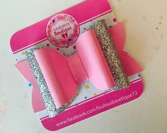 Medium patent pink leatherette bow