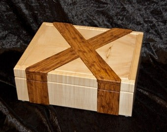 Dovetailed box in rippled sycamore and brown Oak.