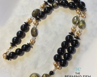 Dark Warrior - Black beaded necklace, gold tribal beads, short necklace.