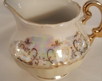Rainbow colored vintage creamer