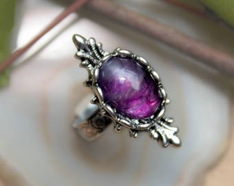 Antique silver with a purple amethyst ring