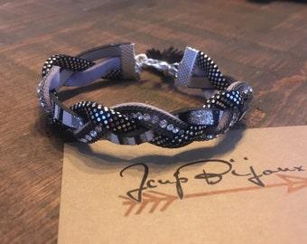 Braided bracelet. Gray, black, white. Adjustable.