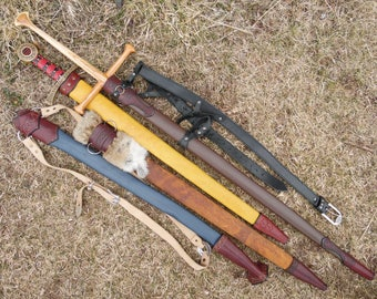 Custom made leather sword scabbards and wooden swords