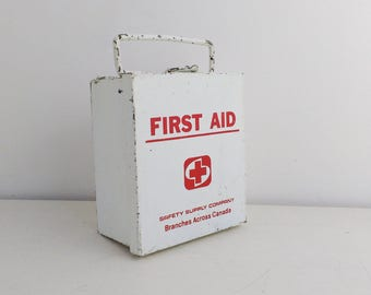 Small vintage first aid box, white and red metal travel box by the Safety Supply Company