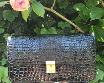 Cover style crocodile leather hand varnished, clasp has push. Vintage french clutch 1980