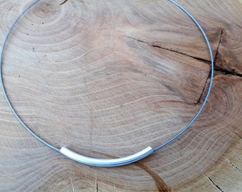 Necklace with metal tube