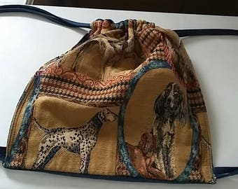 Sliding straps backpack made of fabric showing breed dogs