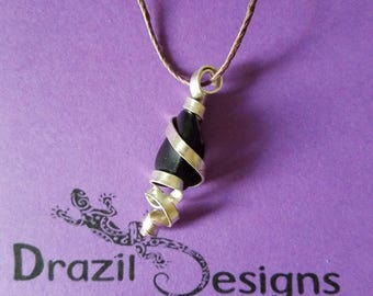 Wire wrapped black polished stone