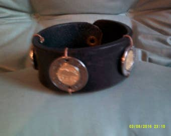 Men's Leather cuff, in Black Leather,  Ornamental Coins. Brass snap