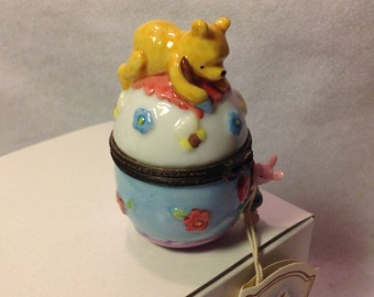 Winnie the Pooh atop a large egg with Piglet PHB Disney by Midwest of Cannon Falls