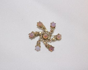 Vintage, small pink and rhinestone swirl brooch