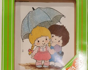 Boy and Girl Under the Umbrella