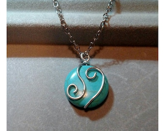 Silver and blue swirl necklace