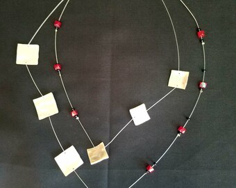 Red necklace with pearl shells