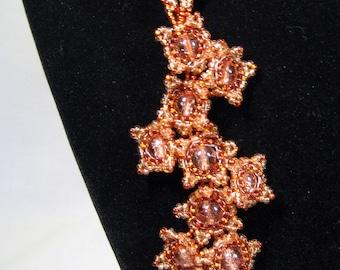 Beaded orange flower lariat necklace