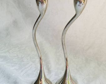Pair of curved metal silvertone taper candle holders