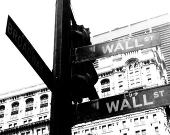 Wall St.: Black and white pedestrian perspective photograph; New York City