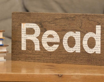 "Wood and book ""Read"" sign"