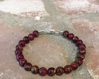 Ruby and pyrite bracelet on sterling silver wire