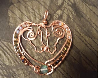 Copper wirework horses in heart necklace