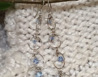 Silver art circle dangle earrings with purple crystals