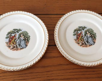 The Harker Pottery Co. colonial couple plates