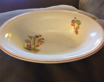"Edwin M. Knowles ""Tia Juana"" 9 3/4"" wide oval serving bowl."