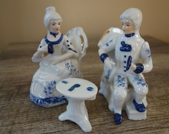 Blue White and Gold Colonial Figurines