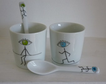Two coffee cups and spoons in porcelain hand painted light green/blue