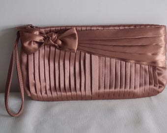Sale:    A pink satin clutch bag.