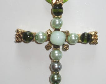 Unique golden cross of 6.5 cm by 4.5 cm in glass beads and cat's eye.