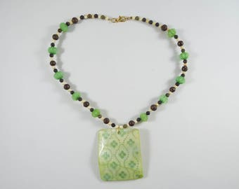 Green necklace with dyed shell pendant