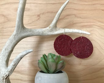 Dark red stamped leather circle earrings