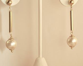 Majorica Pearl drop earrings in golden Rhodium silver