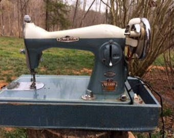 Vintage Dressmaker Sewing Machine. Retro Photos. Studio Seamstress.