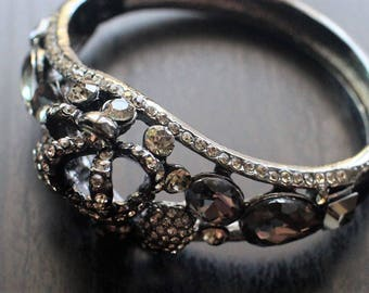 Skeleton design bangles with cubic zirconia on brass