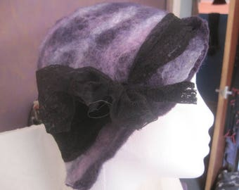 Hand felted merino wool cloche hat in shades of purple with lace ribbon.