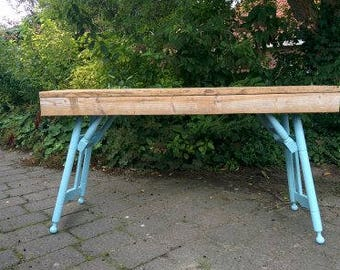 Rustic table of used wood and old oak chairs