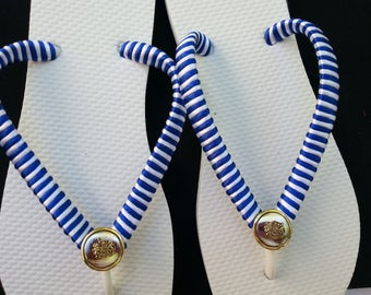 White flip flops with white and blue satin ribbon and gold buttons.  White and blue summer flips flops.  Beach white and blue flip flops